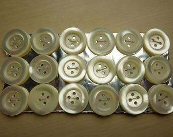 18 old mother of Pearl buttons on card, 4 holes 18 mm
