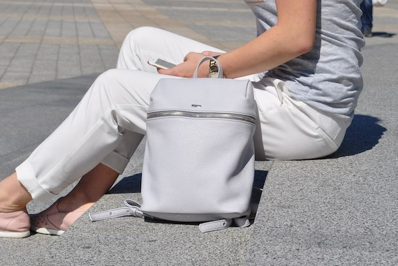 Light gray zipped leather backpack