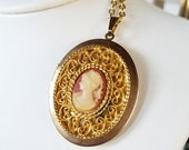 Vintage Gold Tone Cameo with Blush Pink Background Locket Pendant on Gold Tone Necklace