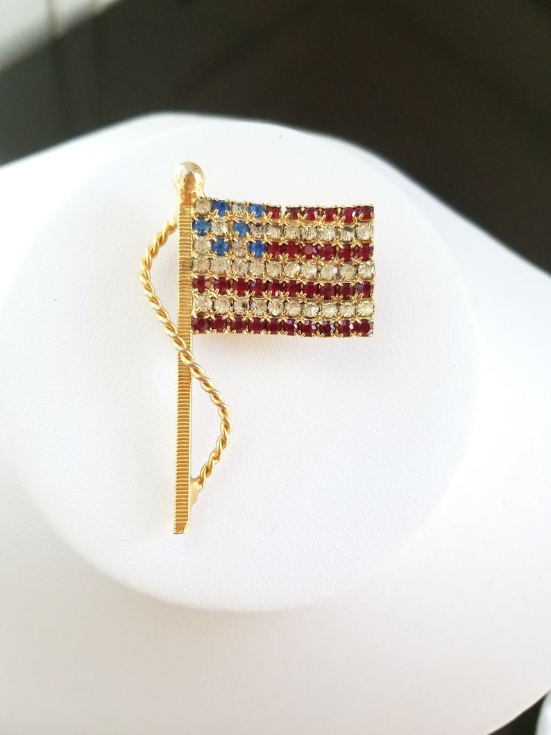 Vintage American Flag pin offered by VintageChicFinds on Etsy. Come be inspired by 4th of July Tablescapes, Patriotic Decor & USA Finds: Happy Birthday, America in case you're in the mood for American flag and red, white, and blue festive finds.