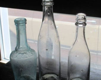 3 Antique sauce bottles