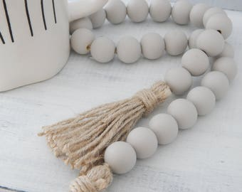 3cbe86487376 Light gray wood bead garland with jute tassels, boho home decor, jewelry  for the home, rustic bead garland, farmhouse beads