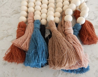 Natural wood bead garland with cotton tassels, boho home decor, jewelry for the home