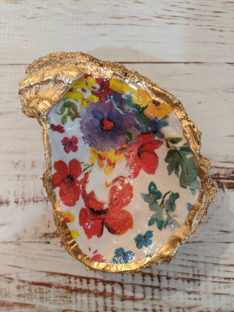 Authentic Clam shell with floral design and hand painted gold rim.