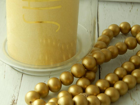 Gold wood bead garland with jute tassels, boho home decor, farmhouse beads