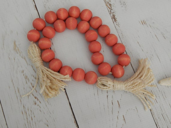 READY TO SHIP Sunwashed coral stained wood garland, creamy beige jute tassels, boho home, beach house decor