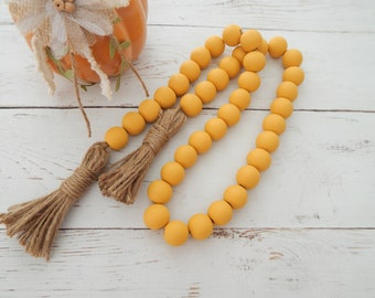 Mustard yellow wood bead garland with jute tassels, boho home decor, jewelry for the home, rustic bead garland, farmhouse beads