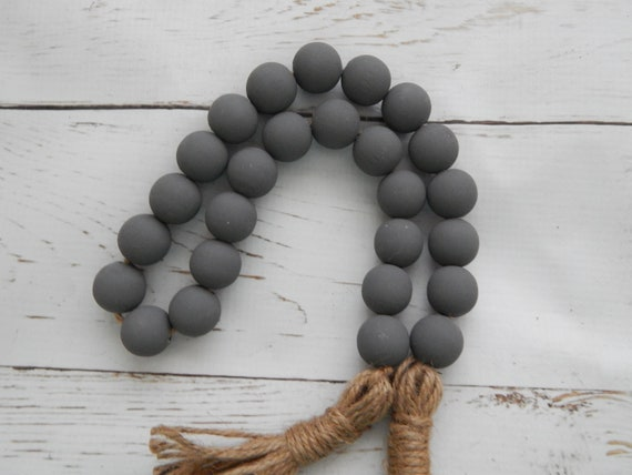 Dark gray wood bead garland with jute tassels, boho home decor, jewelry for the home, rustic bead garland, farmhouse beads