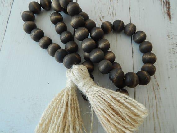 Dark brown stained wood bead garland with creamy beige jute tassels, boho home decor, farmhouse beads, beach house decor