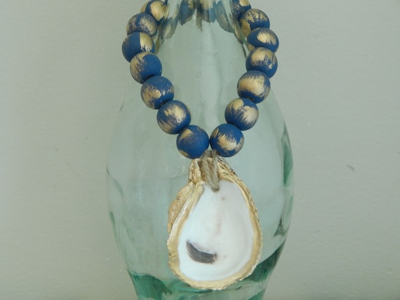 Gold oyster shell with wood beads, shell decor, welcome beads, coastal decor, wood loop garland, navy and gold