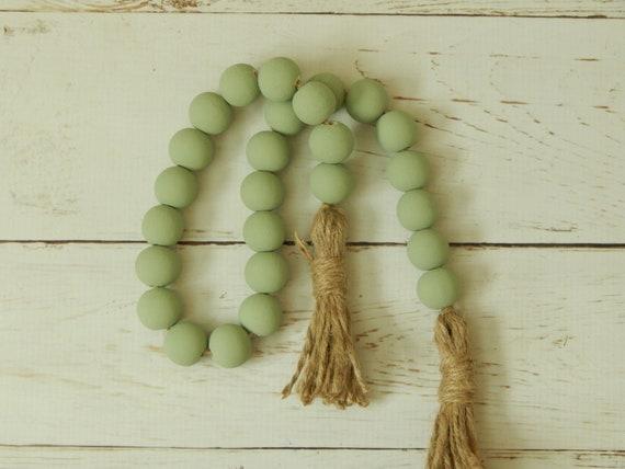 Sage green wood garland with jute tassels, farmhouse beads, beach house decor
