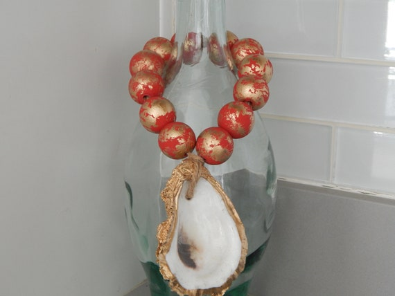 Gold oyster shell with wood beads, shell decor, welcome beads, coastal decor, wood loop garland, red and gold