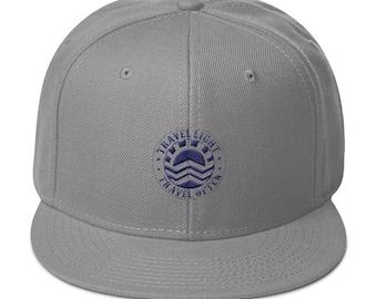b2d65704426dc Travel Light Travel Often Snapback Hat