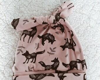 pink old birth cap