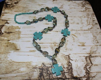 Turquoise cross and iridescent beaded necklace