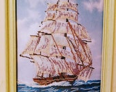 Sailor Ship in Ocean. The Sailing Ship is made in cold shades. The Sails in white, blue and lilac colors, the plastic framed off-white