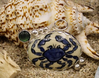 """Blue - hand painted Crab on pottery """"stone"""" with Black Shell in Sterling Silver pendant (610)"""