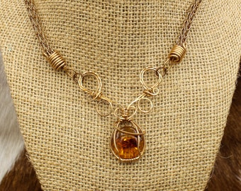 Álfröðull - Bronze and Baltic Amber Elven Swirl pendant on Viking Knit necklace