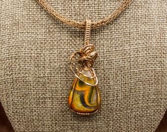 Bronze wrapped bumblebee jasper pendant