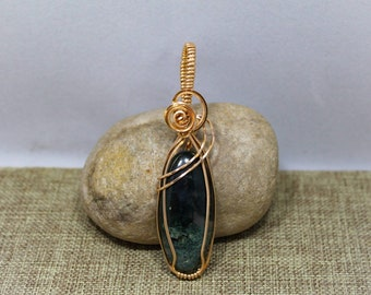 Bronze wrapped moss agate pendant