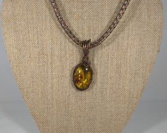 Copper wrapped baltic amber pendant