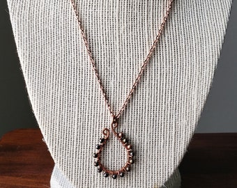 Wire wrapped hand hammered copper elongated horseshoe necklace multicolor metal accent beads