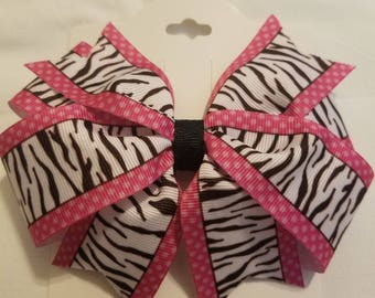 Zebra stripe and pink polka dot bow.