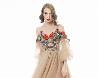 Tulle evening gown with handmade embroidery