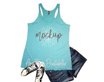 Download Free Next Level | 6733 | Tahiti Blue | Ladies Triblend Racerback Tank | Shirt Mockup | Shirt Flat Lay | White Background PSD Template