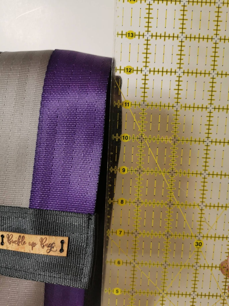 Upcycled seatbelt backpackcrossbody travel bag made from reclaimed seatbelt Recycled ladies bag purple backpack with pockets and  zippers