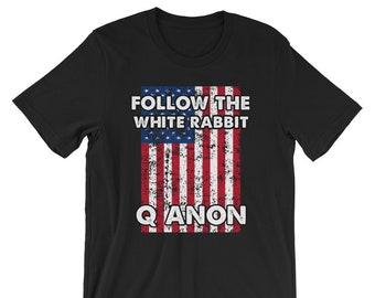 Qanon Shirt Follow The White Rabbit Qanon T Shirt. Deep State qanon tshirts. Qanon flag shirts.White Rabbit Shirt. Qanon shirts for patriot