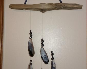 Wind chimes seashells and driftwood