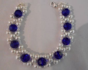 White pearl beads with blue faceted glass beads
