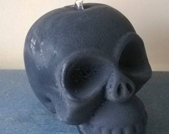 Candle crafted in the shape of skull black