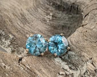 Unique Sea Blue Zircon Birthstone Stud Earrings  in 14k White Gold Baskets