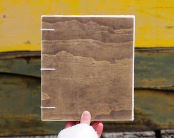 Small dark wood, cream string