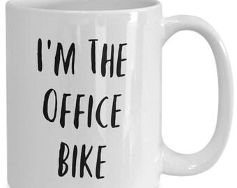 I'm the office bike and I like to drink coffee from my white ceramic coffee mug I got from my secret santa,