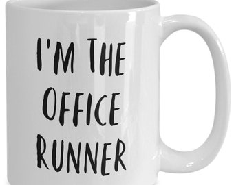 I'm the office runner and I like to drink coffee from my white ceramic coffee mug I got from my secret santa,