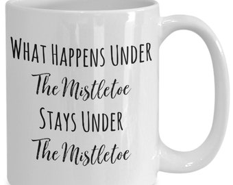 What happens under the mistletoe stays under the mistletoe, Ceramic Christmas Coffee Mug funny gift for friend and family