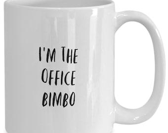 I'm the office bimbo and I like to drink coffee from my white ceramic coffee mug I got from my secret santa,