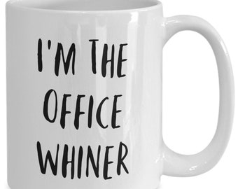 I'm the office whiner and I like to drink coffee from my white ceramic coffee mug I got from my secret santa,