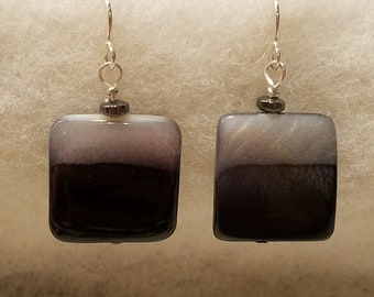 Dangle earrings featuring black and white glass square bead with hematite disk on sterling silver ear wires