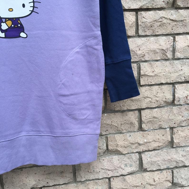 HELLO KITTY sweatshirt spell out big design.. vintage sweatshirt. raglan sweatshirt. size M. womens size