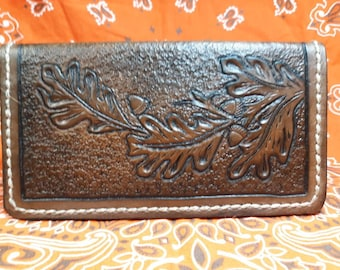 Genuine Leather Checkbook cover all hand tooled and hand made.