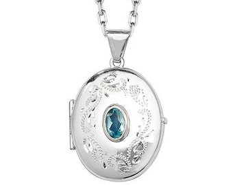 Sterling Silver Engraved Oval Shaped 2 Photo Locket With Centre Blue Topaz