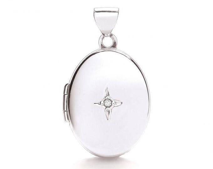 9ct White Gold Small Oval Shaped 2 Photo Locket Set With Single Diamond Hallmarked