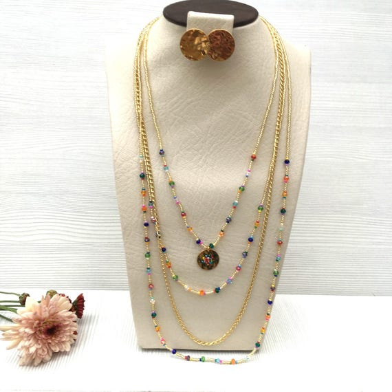 Multistrand necklace with pendant and earrings