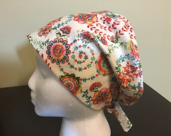 Women's Scrub Cap, Scrub Hat, Surgical Cap beige background with a multi coloured flower, and paisley print /nurses/doctors/veterinarian