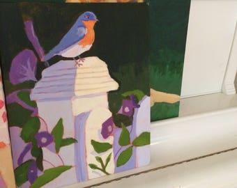 A Bird on a Wooden post