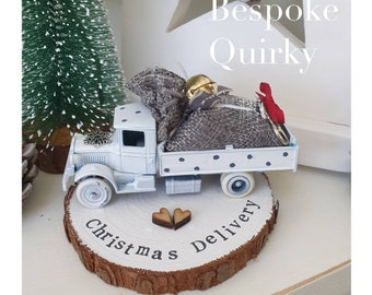 White vintage truck with a sack full of gifts & bike .Personalised Snowy Log Slice